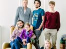 Germany. Edgar and Amelie Rai with their two children, Nelly (9) and Moritz (12), host Syrian refugees and brothers, Bilal (26 - seated) and Amr (17) Aljaber, in Berlin.