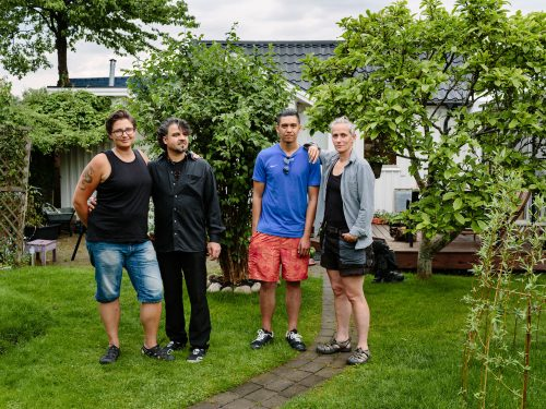 Sweden. Married couple Gabriella and Candel Webster host Syrian Ahmad Lababidi, his son, Ali, 18 and daughter, Hiba (16) who is not pictured, in Malmö.