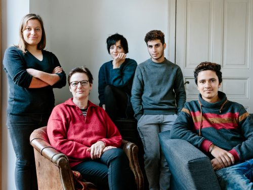 Sabine Waldner with her daughters, Charlotte and Miriam, host two Syrian refugees, Juan (16) and Mohammed (16), classmates from Damascus, at their home in Falkensee, Germany. This portrait is part of the No Stranger Place series, which portrays locals and