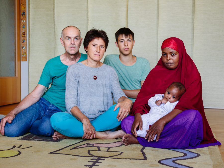 Austria. Marianne Grasl, Rolf Nagel and Leo Grasl (18) host Somali refugee Leyla Mahamud and her baby boy Zacharia who was born April 29, 2016, a few weeks after she moved in, in Vienna.