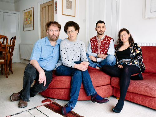 United Kingdom. Simon Goldhill, professor of Greek literature at King's College, Cambridge, his wife Shoshana, a lawyer, and their daughter, Sarah, 27, who is studying medicine, are hosting Faraj, 21, from Aleppo in their Cambridge home. Photo: Aubrey Wade / UNHCR
