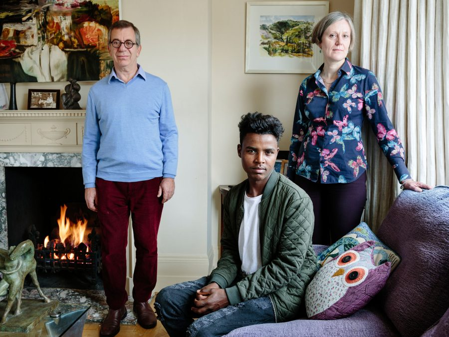 United Kingdom. Charles Elliott, 61, and wife Catharine, 55, have are hosting Hussein, 20, a refugee from Ethiopia in London. Photo: Aubrey Wade / UNHCR